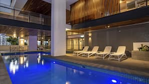 Indoor pool, outdoor pool, open 6 AM to 10 PM, pool loungers
