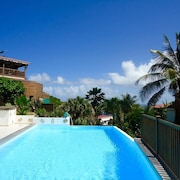 Bungalow With one Bedroom in Le Moule, With Wonderful sea View, Pool Access, Enclosed Garden - 400 m From the Beach