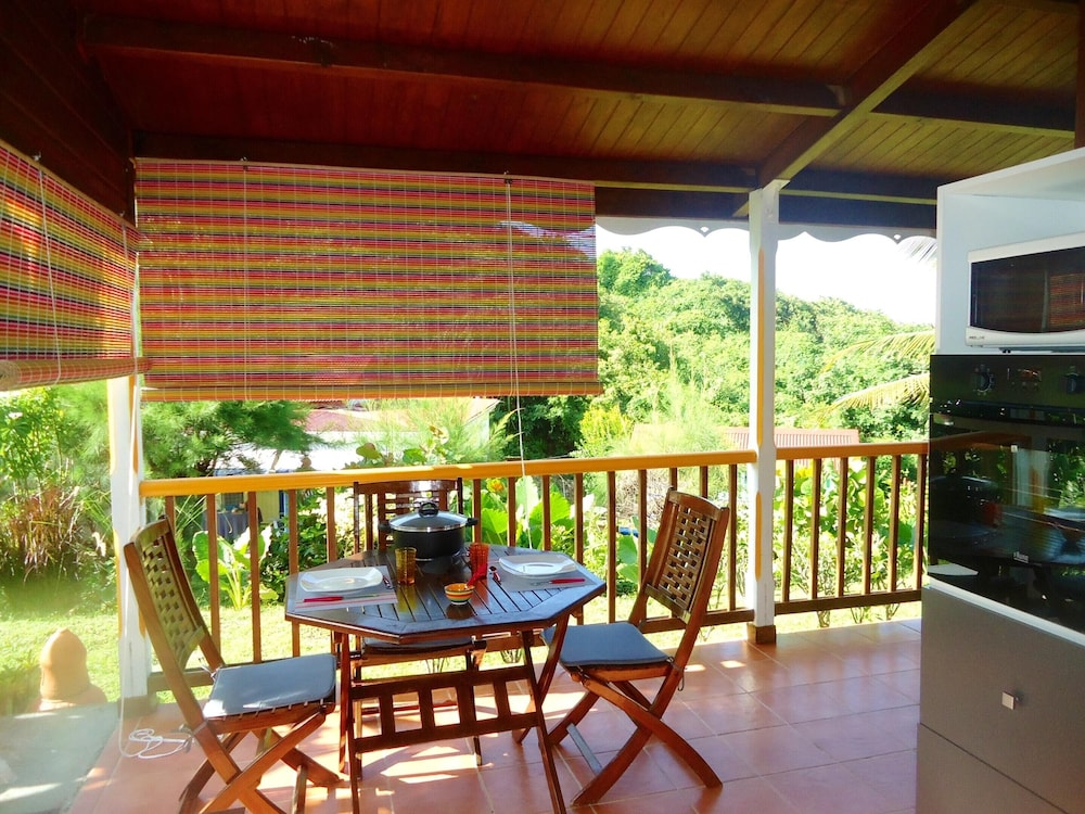 Terrace/Patio, Bungalow With one Bedroom in Le Moule, With Wonderful sea View, Shared Pool, Enclosed Garden - 400 m From the Beach