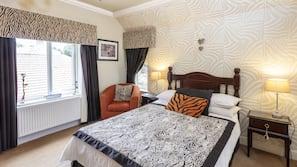 Individually decorated, desk, blackout drapes, iron/ironing board