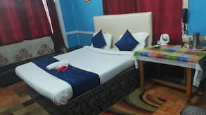 Blackout curtains, iron/ironing board, bed sheets