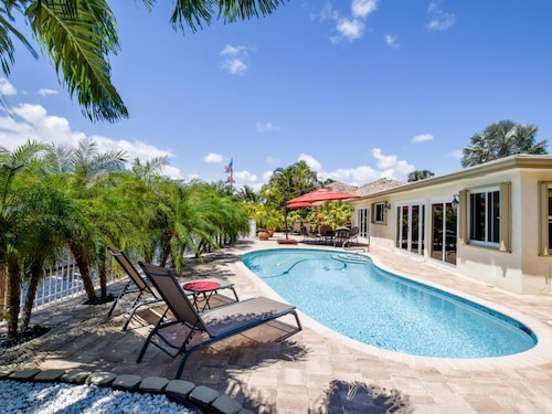Great Place to stay Sweet Pool Vacation House 5 Mins TO Beach Private Dock Boat Lift Intercostal near Deerfield Beach