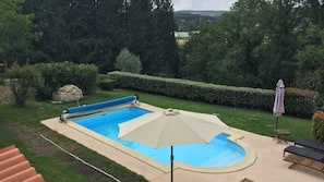 Seasonal outdoor pool, open 9:30 AM to 7:00 PM, pool umbrellas