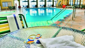 Indoor pool, open 7:00 AM to midnight, pool loungers