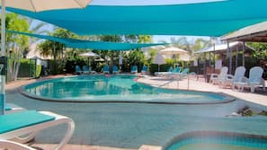 Outdoor pool, open 7 AM to 8 PM, pool loungers