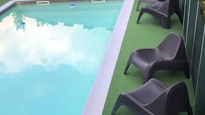 Seasonal outdoor pool, open 9:00 AM to 6:00 PM, pool loungers