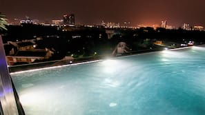 2 outdoor pools, open 8:30 AM to 10 PM, pool loungers