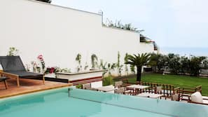 Outdoor pool, open 9:00 AM to 6:30 PM, pool umbrellas, sun loungers