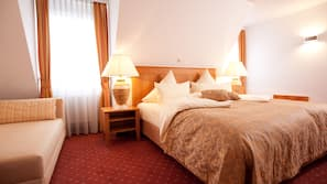 Hypo-allergenic bedding, pillowtop beds, free minibar, in-room safe