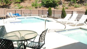 Seasonal outdoor pool, open 9 AM to 9:00 PM, pool umbrellas
