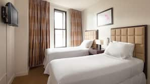 Hypo-allergenic bedding, pillow-top beds, desk, blackout curtains