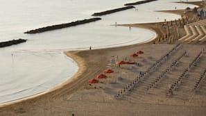 Private beach, beach shuttle, sun loungers, beach umbrellas