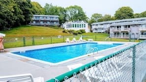 Outdoor pool, open 7:30 AM to 8 PM, pool umbrellas, sun loungers