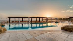 Indoor pool, seasonal outdoor pool, pool umbrellas, pool loungers
