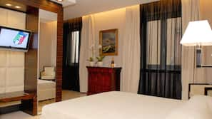 Ropa de cama de alta calidad, minibar, caja fuerte y escritorio