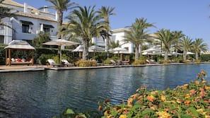 Indoor pool, 3 outdoor pools, open open 24 hours a day, pool umbrellas