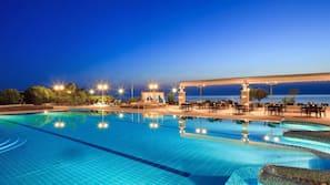 Indoor pool, outdoor pool, pool umbrellas
