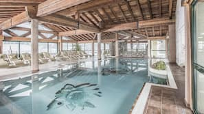 Indoor pool, outdoor pool, pool umbrellas, sun loungers