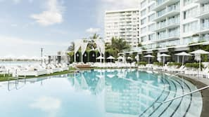 Outdoor pool, open 7:00 AM to 8:00 PM, pool cabanas (surcharge)