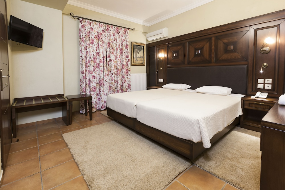 Room, Dellas Boutique Hotel