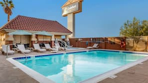 Outdoor pool, open 6:00 AM to 6:30 PM, pool umbrellas, sun loungers