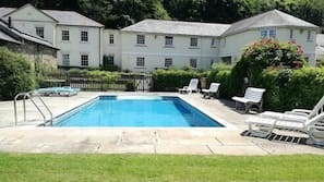 Seasonal outdoor pool, open 10:30 AM to 9:30 PM, pool loungers