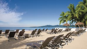 On the beach, beach towels, beach yoga, beach volleyball