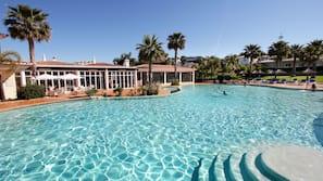 Indoor pool, 2 outdoor pools, open 8:30 AM to 8:00 PM, pool umbrellas