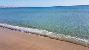 Beach nearby, white sand, free beach shuttle, beach umbrellas