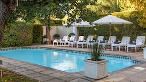 Outdoor pool, open 6 AM to 11 PM, pool umbrellas, sun loungers