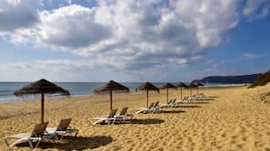 On the beach, white sand, beach umbrellas, beach bar