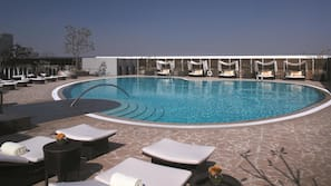 Outdoor pool, open 6 AM to noon, pool umbrellas, sun loungers