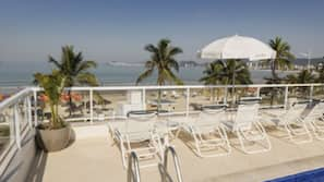Outdoor pool, open 9:30 AM to 9:00 PM, pool loungers