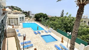 Seasonal outdoor pool, open 11:00 AM to 5:30 PM, pool umbrellas