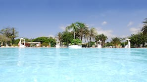 Outdoor pool, open 10:00 AM to 6:00 PM, pool loungers