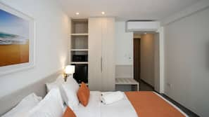 Pillow-top beds, free minibar items, in-room safe