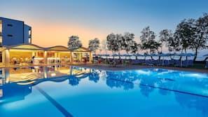 Seasonal outdoor pool, an infinity pool, pool umbrellas, sun loungers