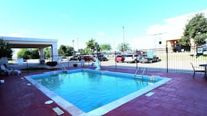 Seasonal outdoor pool, open 10:00 AM to 9:00 PM, pool umbrellas