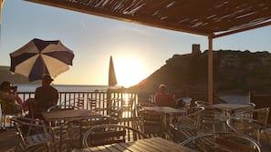 On the beach, sun-loungers, beach umbrellas, scuba diving