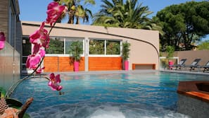 Indoor pool, outdoor pool, open 9:00 AM to 9:00 PM, pool loungers