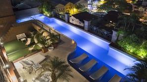 Seasonal outdoor pool, open 6 AM to 10 PM, sun loungers