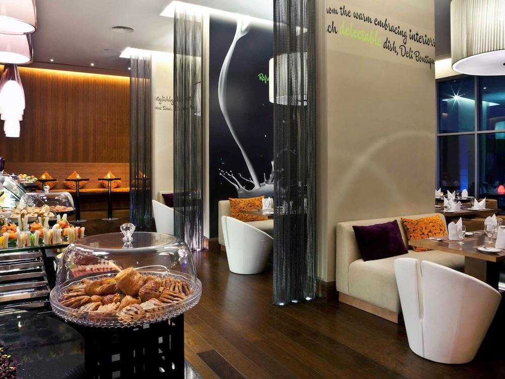 Novotel suites dubai mall of the emirates dubai are for Moquette restaurant