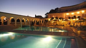 2 outdoor pools, open 9:00 AM to 8:00 PM, pool umbrellas, pool loungers