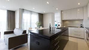 Full-sized fridge, microwave, coffee/tea maker, cookware/dishes/utensils