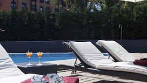 Seasonal outdoor pool, open 11:00 AM to 9:00 PM, pool umbrellas