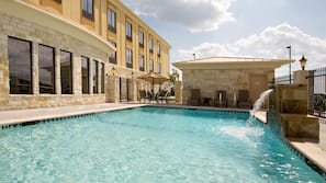 Outdoor pool, open 7 AM to 11:00 PM, pool umbrellas, sun loungers