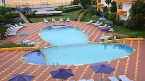Outdoor pool, open 7:30 AM to 7:30 PM, free cabanas, pool umbrellas