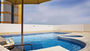 Outdoor pool, open 9:00 AM to 8:00 PM, lifeguards on site