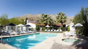 Outdoor pool, open 8 AM to midnight, pool umbrellas