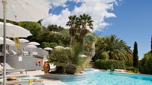 Seasonal outdoor pool, open 9:00 AM to 8:30 PM, pool umbrellas